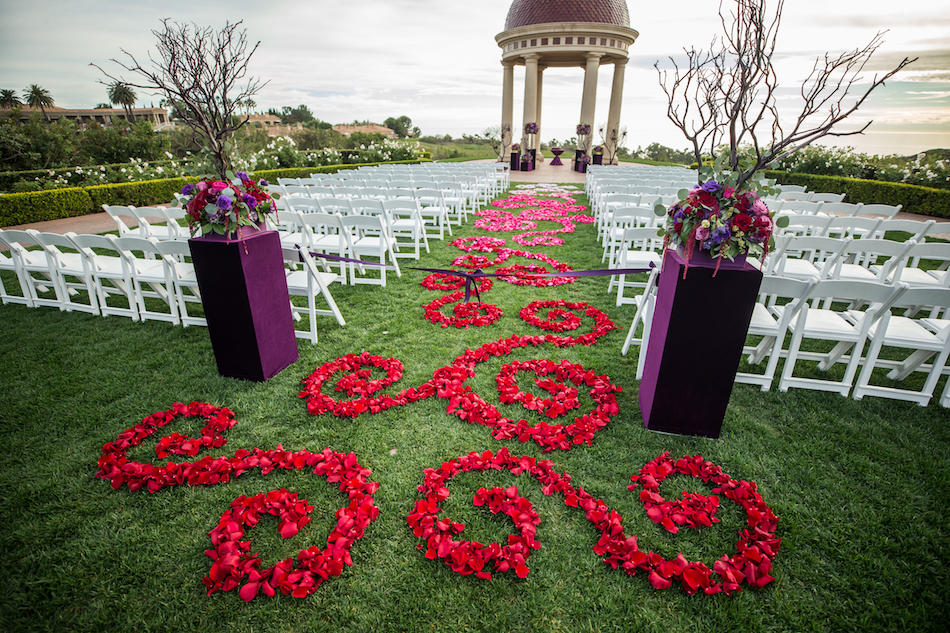 Jewel Toned Pelican Hill Resort Wedding, red floral aisle