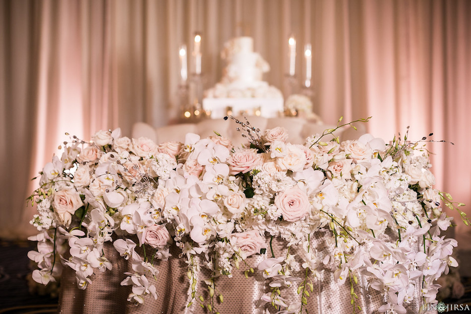 sweetheart table, wedding flowers, flowers, cascade, enchanting laguna cliffs marriott, reception