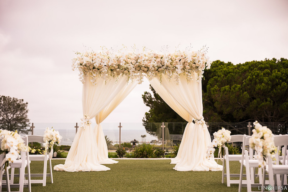 Enchanting gazebo decorations with phalaenopsis, roses, dendrobiums and white drapes