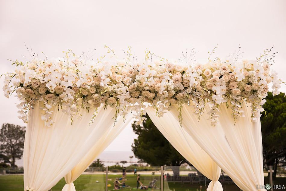 white flowers, flowers, wedding, arch, ceremony, enchanting laguna cliffs marriott