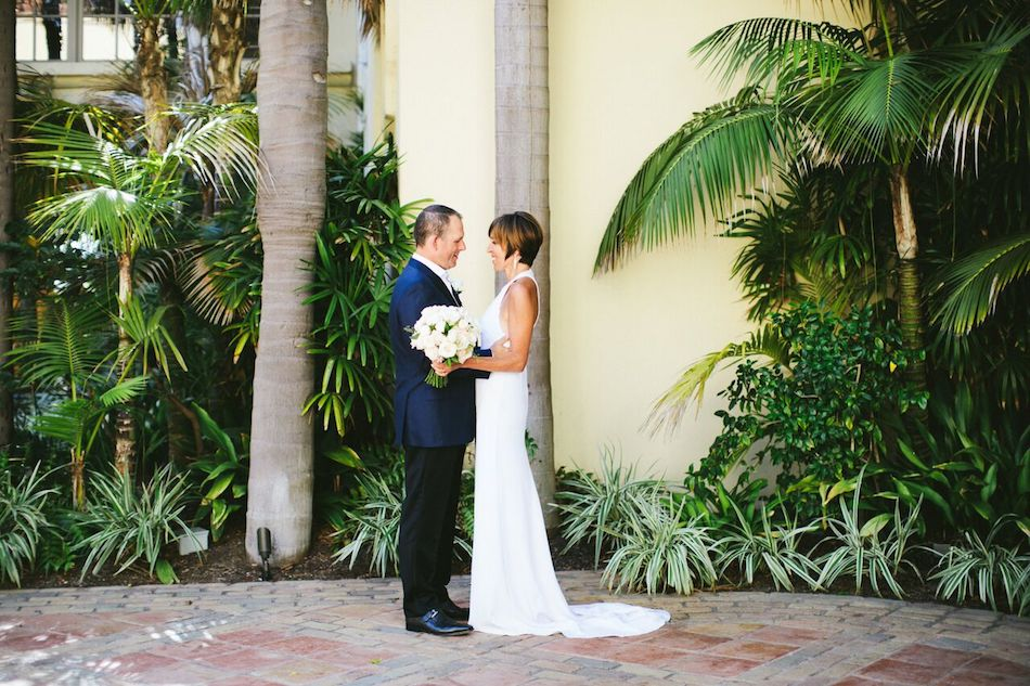 bride and groom, ritz carlton laguna niguel, flowers by cina, wedding flowers, wedding florist, orange county florist, ivory and gold