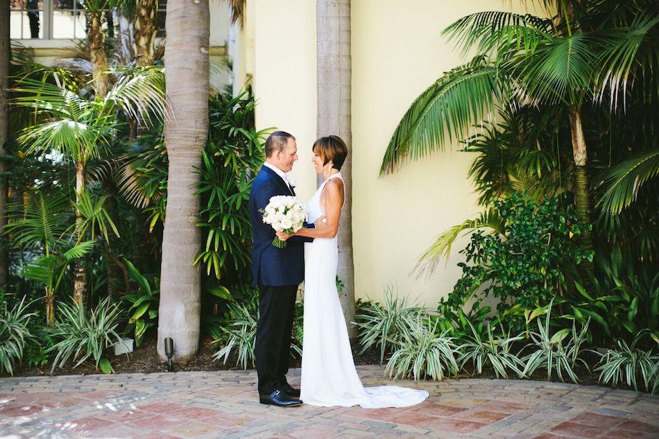 bride and groom, ritz carlton laguna niguel, flowers by cina, wedding flowers, wedding florist, orange county florist, ivory and gold