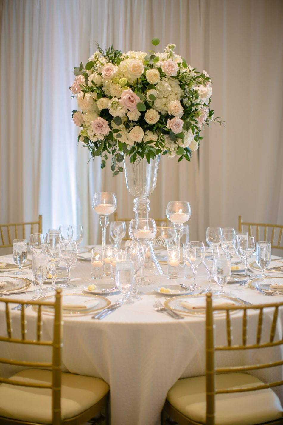 enchanted oceanfront wedding, elevated centerpiece, white centerpiece, blush centerpiece, floral design, florist, wedding florist, wedding flowers, orange county weddings, orange county wedding florist, orange county florist, orange county floral design, flowers by cina
