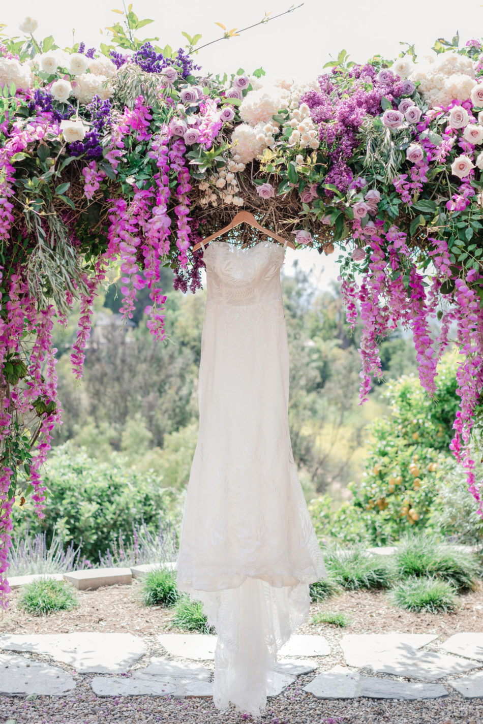 purple floral arch, purple floral-filled chuppah, wedding dress, floral design, florist, wedding florist, wedding flowers, orange county weddings, orange county wedding florist, orange county florist, orange county floral design, flowers by cina