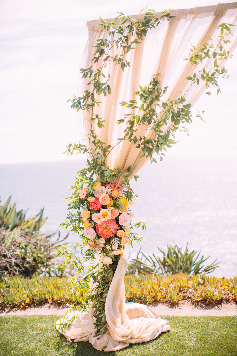 inside weddings feature, floral arch, pink floral arch, floral design, florist, wedding florist, wedding flowers, orange county weddings, orange county wedding florist, orange county florist, orange county floral design, flowers by cina