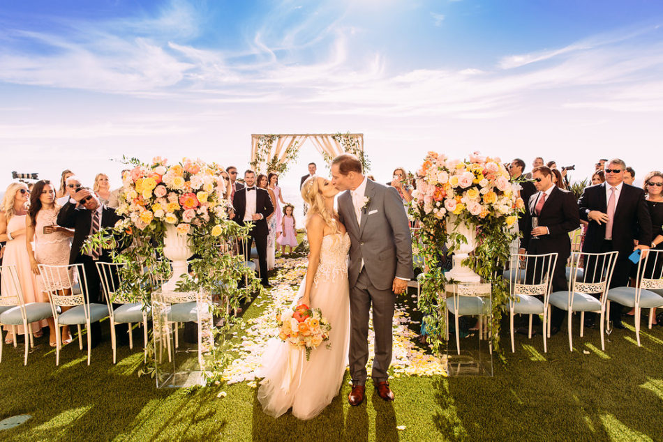 bride and groom, inside weddings feature, first kiss, floral design, florist, wedding florist, wedding flowers, orange county weddings, orange county wedding florist, orange county florist, orange county floral design, flowers by cina