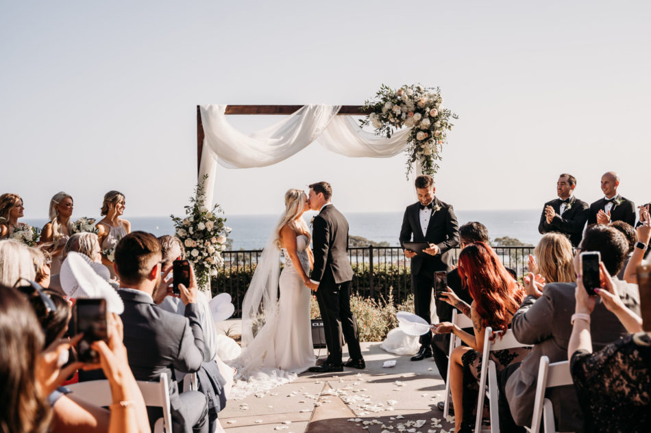 first kiss, bride and groom, oceanfront wedding, floral design, florist, wedding florist, wedding flowers, orange county weddings, orange county wedding florist, orange county florist, orange county floral design, flowers by cina
