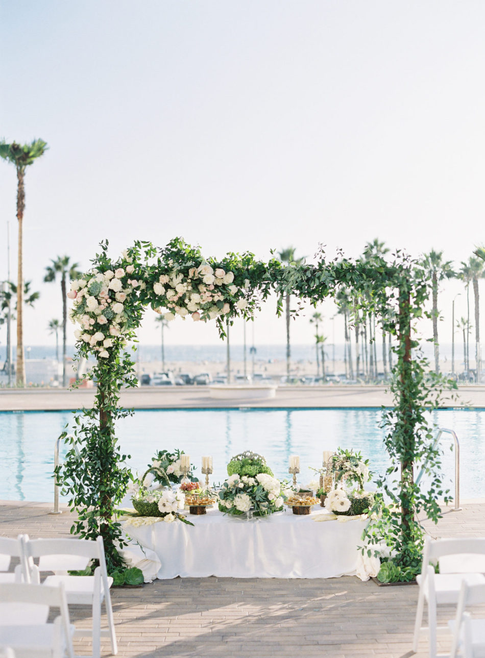 romantic waterfront wedding, floral-filled arch, blush floral arch, floral design, florist, wedding florist, wedding flowers, orange county weddings, orange county wedding florist, orange county florist, orange county floral design, flowers by cina