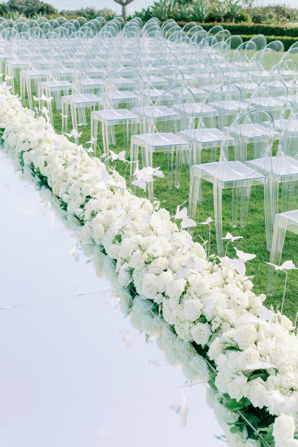 floral-filled aisle, mirrored aisle, lavish oceanfront wedding, floral design, florist, wedding florist, event florist, wedding flowers, event flowers, cabo san lucas weddings, cabo san lucas wedding florist, cabo san lucas florist, cabo san lucas floral design, cabo rentals, flowers and events