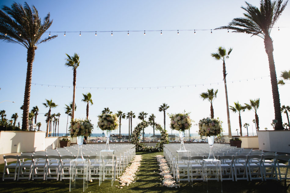 classic blue hued wedding, outdoor ceremony, floral-filled ceremony, beautiful coastal wedding, floral design, florist, wedding florist, wedding flowers, orange county weddings, orange county wedding florist, orange county florist, orange county floral design, flowers by cina