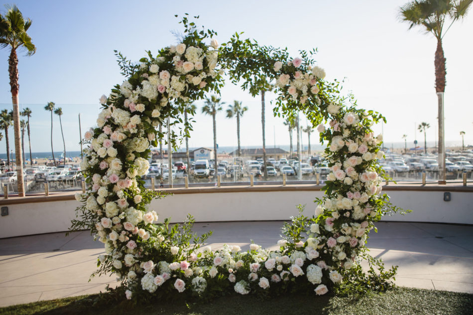 classic blue hued wedding, floral-filled arch, blush ceremony blooms, beautiful coastal wedding, floral design, florist, wedding florist, wedding flowers, orange county weddings, orange county wedding florist, orange county florist, orange county floral design, flowers by cina