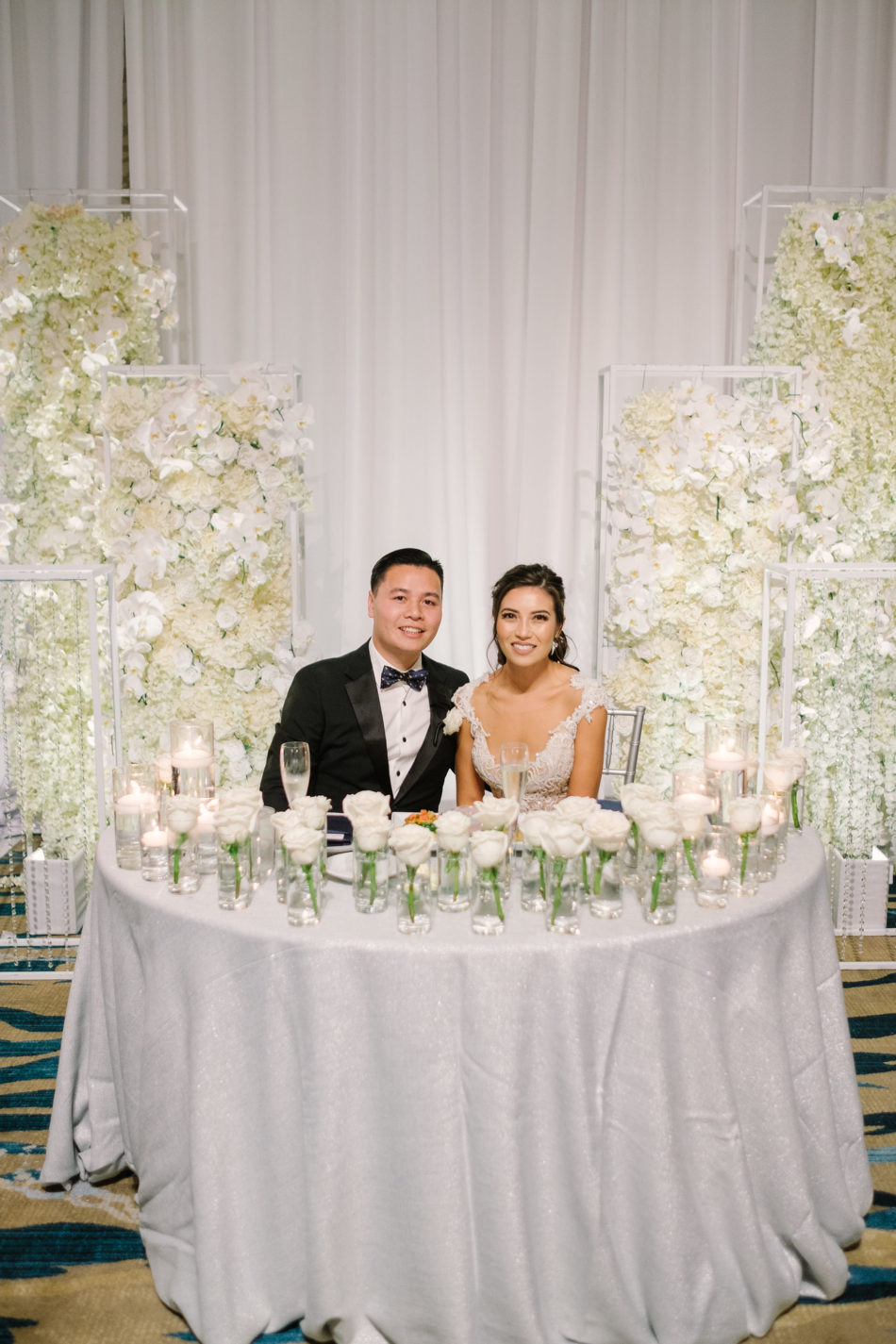 sweetheart table, bride and groom, sweetheart table florals, magnificent all-white wedding, floral design, florist, wedding florist, wedding flowers, orange county weddings, orange county wedding florist, orange county florist, orange county floral design, flowers by cina