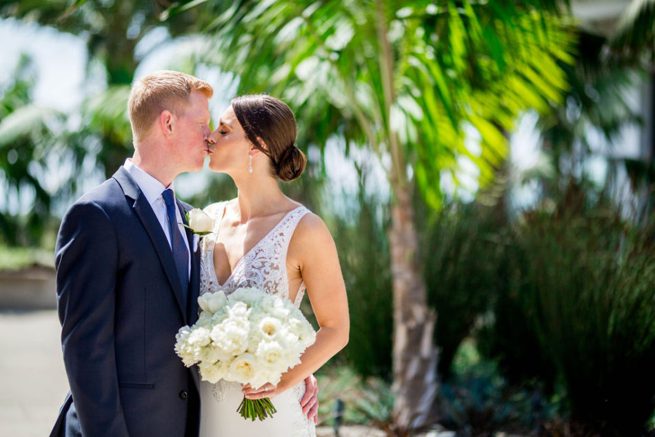 first kiss, newlyweds, ethereal white wedding, florist, wedding florist, wedding flowers, orange county weddings, orange county wedding florist, orange county florist, orange county floral design, flowers by cina