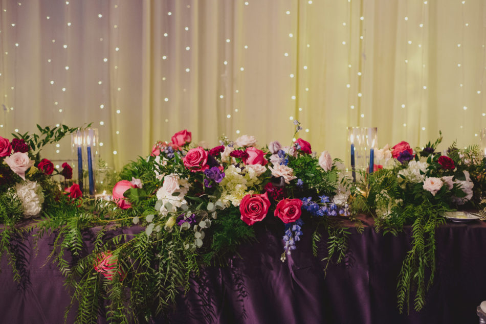 sweetheart table, colorful reception blooms, vibrant oceanfront wedding, floral design, florist, wedding florist, wedding flowers, orange county weddings, orange county wedding florist, orange county florist, orange county floral design, flowers by cina