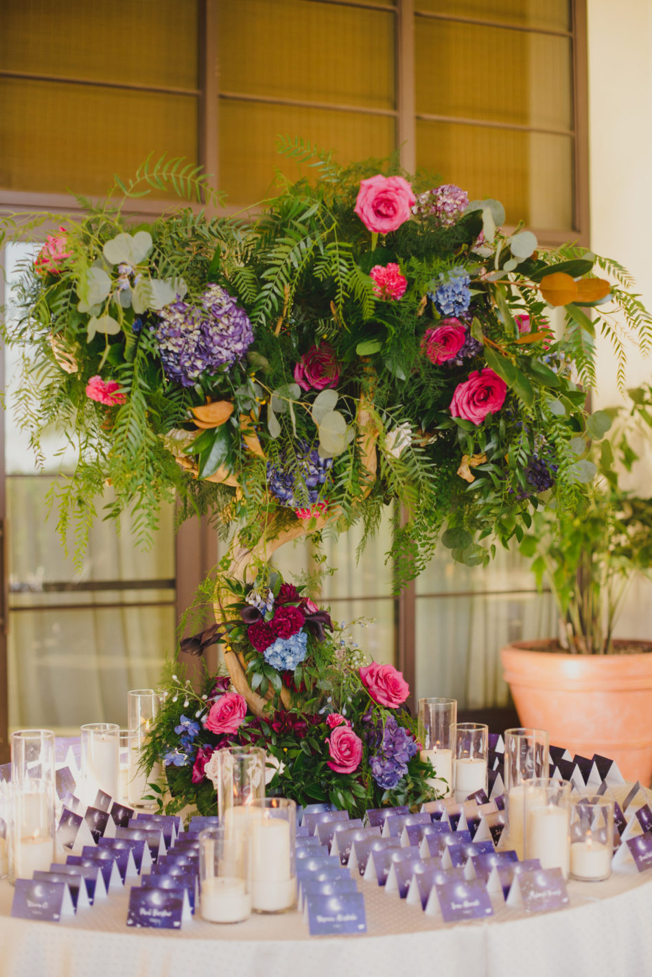 colorful escort card display, purple escort cards, vibrant oceanfront wedding, floral design, florist, wedding florist, wedding flowers, orange county weddings, orange county wedding florist, orange county florist, orange county floral design, flowers by cina