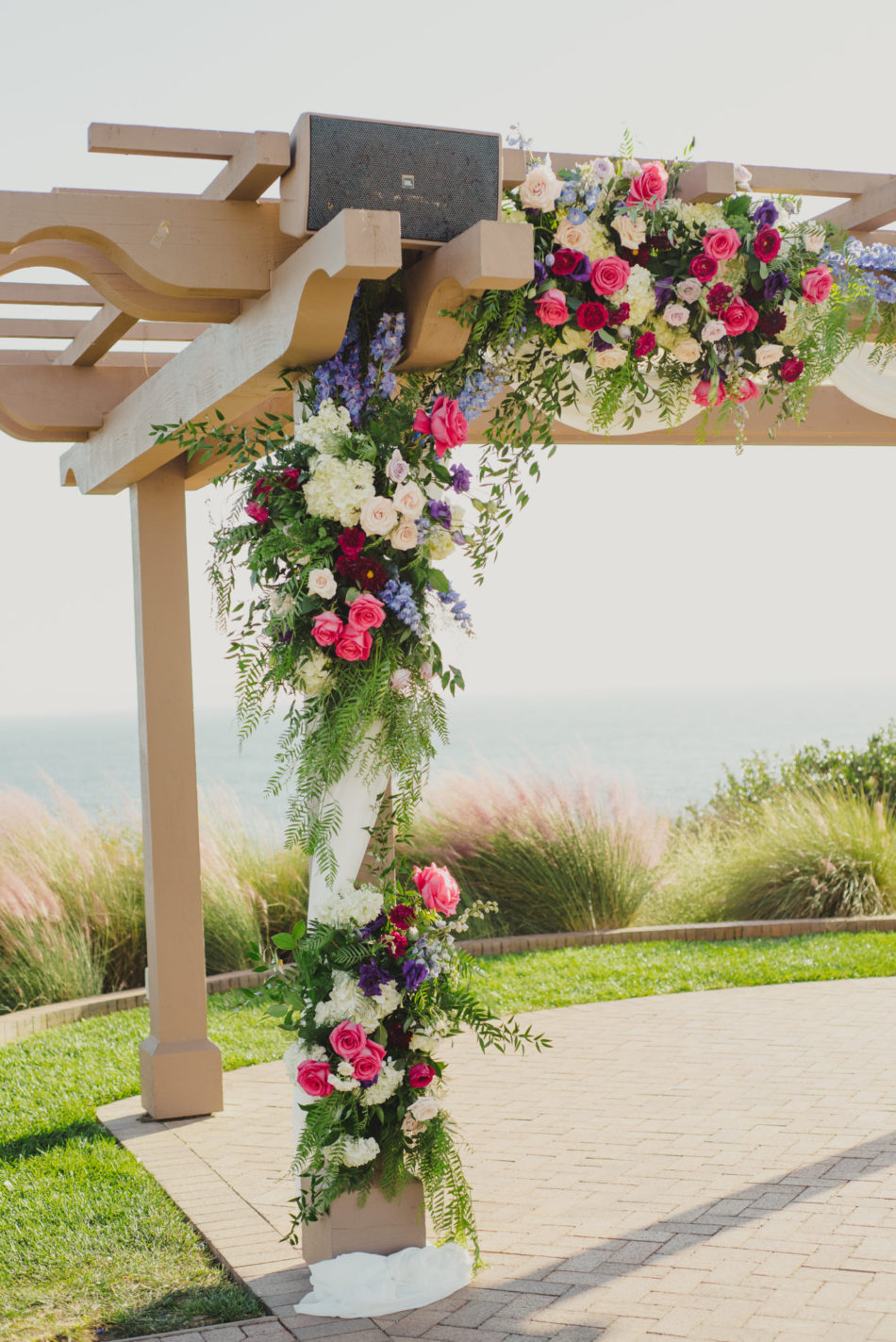 colorful ceremony arch, colorful ceremony florals, vibrant oceanfront wedding, floral design, florist, wedding florist, wedding flowers, orange county weddings, orange county wedding florist, orange county florist, orange county floral design, flowers by cina