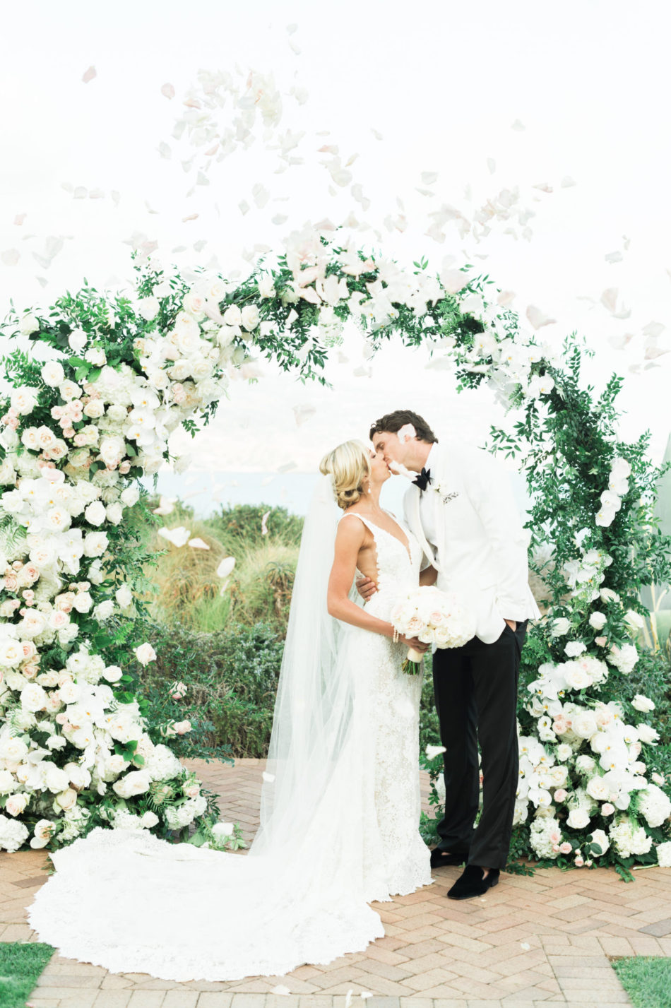 first kiss, bride and groom, romantic all-white wedding, floral design, florist, wedding florist, wedding flowers, orange county weddings, orange county wedding florist, orange county florist, orange county floral design, flowers by cina