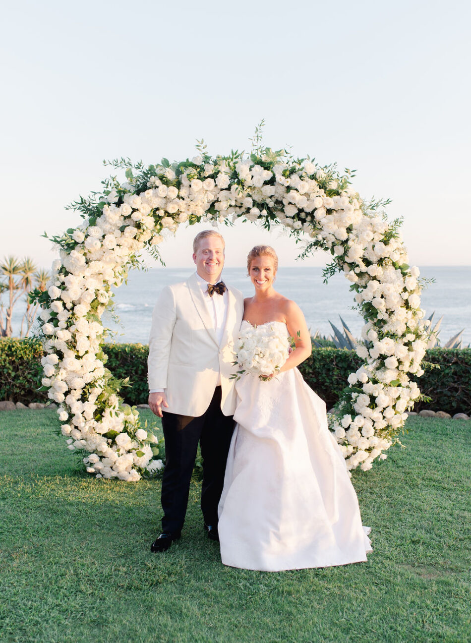 newlyweds, floral arch, ceremony arch, gorgeous oceanfront wedding, floral design, florist, wedding florist, wedding flowers, orange county weddings, orange county wedding florist, orange county florist, orange county floral design, flowers by cina