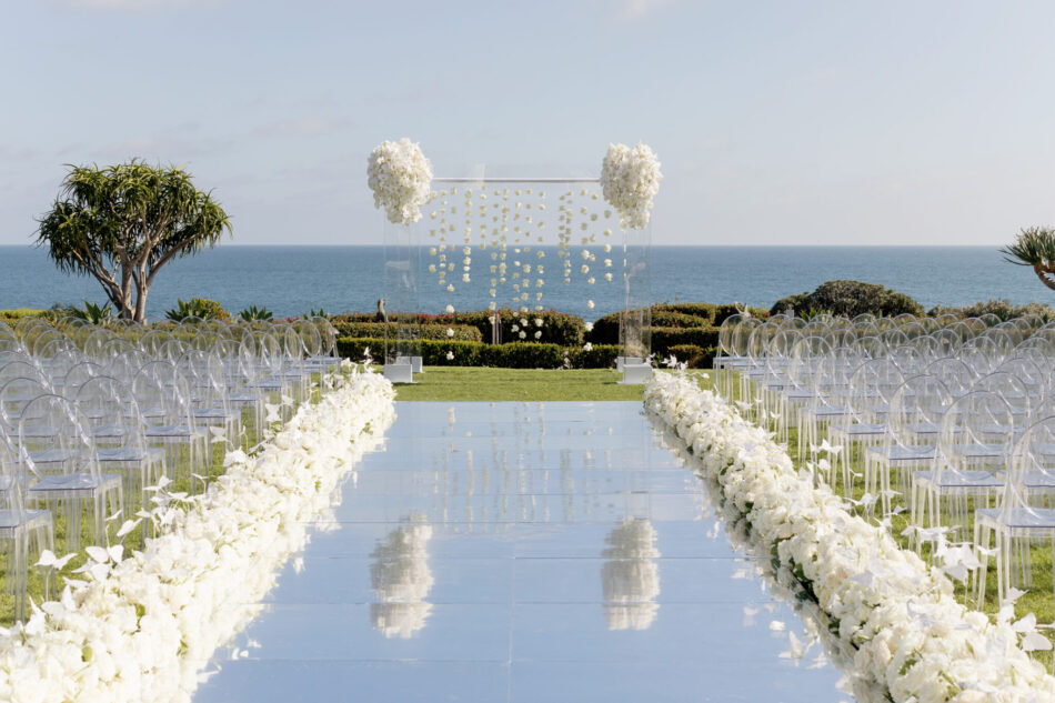 all-white ceremony florals, oceanfront ceremony, memorable floral-filled ceremony setups, floral design, florist, wedding florist, wedding flowers, orange county weddings, orange county wedding florist, orange county florist, orange county floral design, flowers by cina