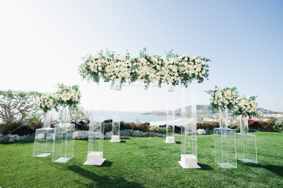 white ceremony arch, floral-filled ceremony arch, floral-filled ceremony, ethereal oceanfront wedding, floral design, florist, wedding florist, wedding flowers, orange county weddings, orange county wedding florist, orange county florist, orange county floral design, flowers by cina