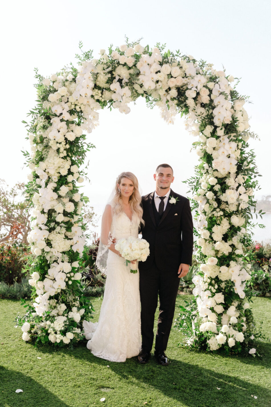 floral arch, newlyweds, beautiful floral-filled wedding, floral design, florist, wedding florist, wedding flowers, orange county weddings, orange county wedding florist, orange county florist, orange county floral design, flowers by cina